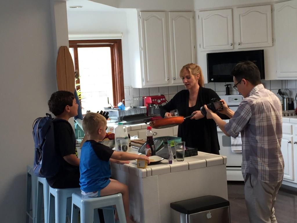Lori serves her kids their breakfast