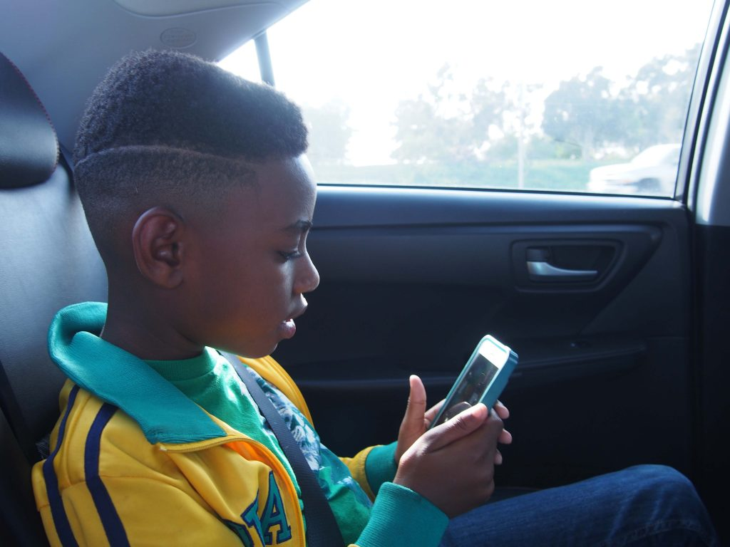 Isaiah getting bored and playing w/ my iphone